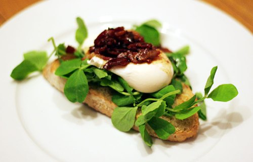 Bacon & egg with peashoots on toast